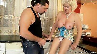 Whorish granny Effie gets banged in kitchen