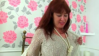 british cougar Janey jacks her unshaven pussy