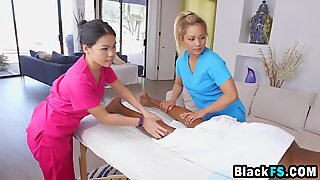 Two Asian minxes massage and receive a huge black cock in gratitude