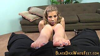 Teen rubs feet on big black cock